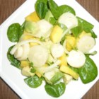 Tropical Hearts of Palm Salad with Mango and Avocado - Hearts of palm are tossed with mango and avocado in a light dressing for a simple tropical salad that will leave you feeling refreshed.