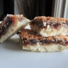 Billy Boy's Butter Tart Slice - These bar cookies have the pastry crust, raisins, and traditional gooey butter and sugar filling of a Canadian butter tart.