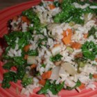 Brown Rice and Kale Salad - This brown rice and kale salad with plenty of vegetables and almonds is a hearty lunch or a side salad alongside steak.