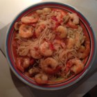 Shrimp Scampi with Angel Hair Pasta - Roast tomatoes for this shrimp scampi recipe packed with garlic and served over angel hair pasta for extra robust flavor on your dinner plate.