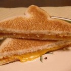 Bachelor Grilled Cheese - Quick and easy grilled cheese for the man who doesn't need to impress anyone with his cooking abilities! A cunning approach for making grilled cheese without using the stove.