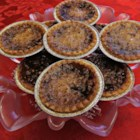 Honey Butter Tarts - This butter tart recipe features a mixture of honey and brown sugar, with lemon juice for a little zing.