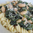 White Bean Rotini - Looking for a satisfying meat-free dinner option? Try this dish packed with white beans, pasta, greens, and a bit of spice.