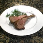 Roasted Rack of Lamb - A rack of lamb is seared, and encrusted with Dijon mustard and garlic and rosemary flavored bread crumbs. Then it is roasted to your desired doneness.