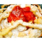 Funnel Cakes I - A puffed fried cake. It can be sprinkled with confectioners' sugar or cinnamon sugar.