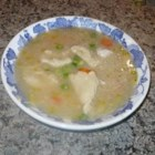 Chicken Dumpling Soup - Chicken dumplings flavored with parsley and tarragon are cooked in a chicken broth soup with carrots and chunks of chicken breast in this golden bowl of goodness.