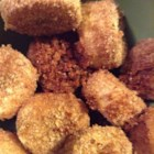Oven-Fried Bananas - These little banana treats are coated in bread crumbs and baked to a delicious, crispy texture. Serve it with fat-free ice cream for a guilt-free dessert.