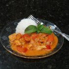 Maple Chicken Curry - Maple chicken and vegetables are seasoned with a creamy curry sauce creating a spicy topping for basmati rice with saffron.