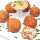 Sauerkraut Sausage Balls - This is a delightful appetizer that can be made ahead of time and heated when guests arrive. Spicy pork sausage and beef will never know what hit them when you blend them with sauerkraut and a cream cheese mixture, then deep fry them to mouthwatering golden perfection.