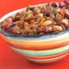Mother Earth's Baked Beans - Baked beans loaded with bacon, ground beef, and plenty of spices and seasonings are simmered in the slow cooker for hours for a hearty side dish. For best flavor, refrigerate cooked beans overnight and reheat the next day.