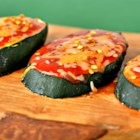 Zucchini Pizza - Zucchini slices are layered with cheese and tomato sauce and pan-fried for a quick and easy crustless pizza appetizer.