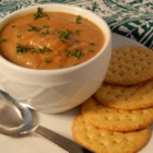 Golden Vegan Cauliflower 'Bisque' - Blending and mashing vegetables in broth and adding coconut milk gives this vegetarian soup recipe a bisque-like texture without the dairy.