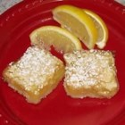 Lemon Bars I - This recipe levels up by putting lemon bars onto a shortbread base, blending two great ideas into one delightful treat.