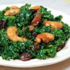 Kale Salad with Sugar-Coated Cashews - This kale salad is dressed with soy sauce and tossed with raisins and sugar-coated cashews for a delicious summer treat.