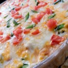Tex-Mex Chicken Casserole - This creamy chicken casserole with a nacho cheese-flavored corn chip crust is a comforting dish your whole family will love.