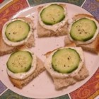 Italian Cucumber Sandwiches - These little open faced cucumber sandwiches are always a hit, and I never leave a party without getting asked for the recipe several times! Allow the mayonnaise mixture to sit overnight in the refrigerator if you have the time -- it will taste even better.