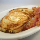 Egg in a Hole - Using bacon drippings in the skillet brings added flavor to this breakfast classic.
