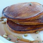 Double Pumpkin Pancake - Pumpkin puree and toasted pumpkin seeds are a tasty duo in these double pumpkin pancakes; serve with maple syrup and butter.