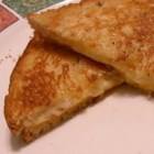 Cheesy Grilled Cheese - This is my version of the best grilled cheese inspired by a local restaurant in DC. Rye bread is broiled with three types of cheese then pressed together to make a masterpiece of a hot sandwich.