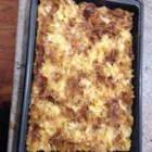 Lynn's Easy Noodle Pudding - Tossed with creamy cottage cheese, sour cream. beaten eggs, and raisins, and topped with a cinnamon sugar-raisin mixture, baked egg noodles acquire a heavenly personality in this dish fondly known to many as 'kugel.'