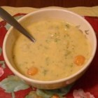 Beer Cheese Soup III - Condensed cream of chicken soup and processed cheese are added to potatoes, celery, onion and frozen broccoli cooked in chicken bouillon to create this rich soup.