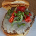 Beach House Burgers - Mix together ground sirloin and ground chuck, form into patties and toss on the grill with some mozzarella cheese to make these delicious beach house burgers.