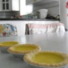 Hong Kong Style Egg Tarts - Very easy to make Chinese style Egg Tart, you can put the leftovers in the refrigerator for later use for up to 3 days. You can reduce the sugar used on the crust and the filling to fit your taste, this recipe is lightly sweetened. If you want to you, can add more sugar to the filling. Hope you enjoy it!