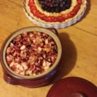 Cranberry Salad III - What 's nice about this version of cranberry salad, is the orange rind, you can taste it in every bite. And the raspberry flavored gelatin that all the ingredients are stirred into, adds another taste dimension. Serves eight.