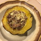 Squasage (Sausage-stuffed Squash) - Squash stuffed with a creamy sausage filling is the perfect addition to the Thanksgiving table or for a fancy weeknight dinner.