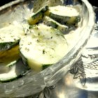 Creamy Garden Cucumber Salad - A ranch-flavored dressing made with sour cream, half-and-half, and mayonnaise is the base for this simple cucumber salad.