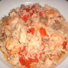 Jenny's Jambalaya - Chicken, sausage, and shrimp are seasoning with a hot spice mix and served over rice in this recipe for jambalaya.