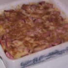 Polish Reuben Casserole - Layers of sauerkraut, egg noodles, a creamy mushroom mixture, Swiss cheese and bread crumbs build up to form this casserole named after the famous sandwich.