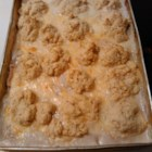Chicken, Rice, and Biscuit Casserole - If you love rice, cream of chicken soup, and biscuits, this is the meal for you.