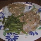 2-Step Garlic Pork Chops - Saucy pork chops simmer in a creamy garlic and mushroom mixture, perfect over rice or couscous.