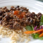 Cubanos Frijoles - Originally this came from a Cuban friend, but I've since doctored it quite a bit.  This dish is hearty and a meal in itself.  By adding more meat, beans, and rice, you can feed a large group of people.  You might want to add more spice as well.
