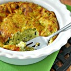 Sharyn's Zucchini Quiche - Sprinkle zucchini with a teaspoon of salt and allow it to drain in a colander for about 15 minutes for a drier quiche. Biscuit mix helps the eggs set.