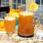 Peach Orange Iced Tea - Peach-orange iced tea made with fresh peaches and oranges is a refreshing drink on hot summer days.