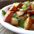 Kielbasa with Peppers and Potatoes - Kielbasa cooked with red and yellow peppers and potatoes.