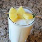 Banana Pina Colada Smoothie - Banana, pineapple, and coconut juice are blended together creating a pina colada-flavored smoothie for a tropical start to your day.