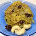 Saffron Rice with Raisins and Cashews - Basmati rice is simmered with clarified butter, cloves, raisins and cashews to create this authentic, slightly sweet taste of India.