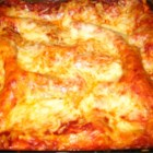 Creamy Chicken Lasagna - Poached chicken, bouillon, cream cheese and mozzarella make a fabulously creamy stuffing for this rich lasagna. Spaghetti sauce and more mozzarella are baked over the top.