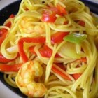 Singapore Noodles - Here is a somewhat spicy curry dish of vermicelli noodles with a medley of veggies and shrimp, chicken, and pork. It's an Asian way to  clear out the fridge.
