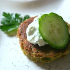 Sean's Falafel and Cucumber Sauce - It's easy to make your own falafel! Mashed chickpeas are combined with onion, bread crumbs, egg, and herbs, and fried until browned and crisp. Serve in pita halves topped with chopped tomatoes and cucumber sauce.