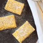 Gluten Free Lemon Coconut Poppy Seed Bars - Delicious treat and gluten free! Bars can be made up to 3 days in advance and stored in the refrigerator in an airtight container.