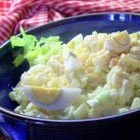 Southern Potato Salad - This warm potato salad is a classic, with mayonnaise, sweet pickle, garlic, mustard, bits of celery, and diced hard boiled eggs.