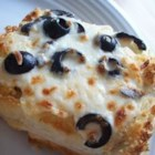 Cheese and Olive Bread - French bread is topped with a creamy mixture of mozzarella, olives, mayo, butter, garlic and onion powders, and then baked to a delicious golden brown finish.