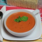 Favorite Basil-Tomato Soup - Get a delicious pot of creamy, basil-tomato soup by simmering crushed tomatoes, fresh basil, chicken broth, and cream together. Don't forget the butter!