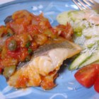 Sea Bass Cuban Style - Sea bass cooked in tomato, onion, caper, and white wine sauce. Great served with rice pilaf.