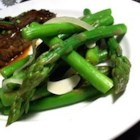 Asparagus with Garlic and Onions - Asparagus and onions are steamed until tender, then quickly browned in butter with garlic.