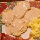 Sausage Gravy - Grandma's own!  Adjust the milk to the thickness you like.  Works with bacon, too. Serve hot over freshly baked biscuits!